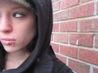chick with multiple piercings
